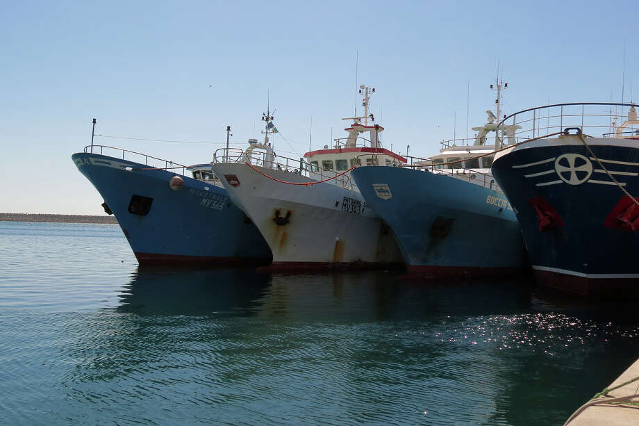 "Three Italian fishing boats, ""Boccia"", ""Maestrale"" and ""Antonino Serrato"" with 21 people aboard, were seized by the Libyan military and forced to dock in the port of Benghazi, Libya, Friday, June 8, 2012. (AP Photo/Ibrahim Alaguri) Photo: Ibrahim Alaguri / AP"