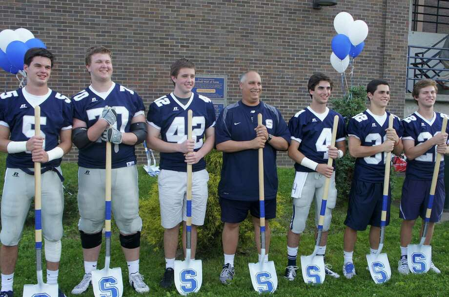 """Staples head football coach Marce Petroccio, flanked by the team's senior captains for the 2012 season, gather at a """"groundbreaking"""" ceremony for the upcoming of field lights at Staples' stadium. From left, are: Nick Kelly, Kyle Vaughn, Kevin Kearney, Petroccio, James Frusciante, Greg Strauss and and Joey Zelkowitz. Friday, June 8, 2012/ Westport, CT Photo: Paul Schott / Westport News"""
