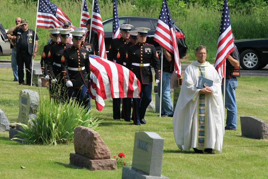 Marine pallbearers carry the casket of Marine Pfc. John Albert Donovan after his funeral in Michigan on Friday, almost 70 years after he was declared dead. Photo: Carlos Osorio / AP