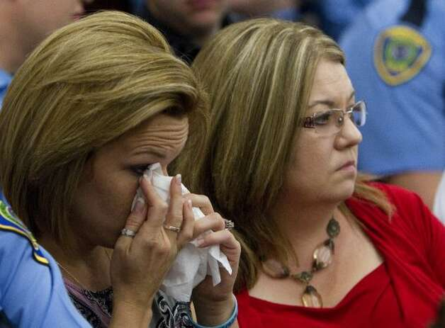 Alisha Will, left, sits with her mom, Cyndee Graham, right, during the sentencing of Johoan Rodriguez for the death of her late husband Houston Police Officer Kevin Will in the 183rd state District Court Friday, June 8, 2012, in Houston.  (Cody Duty / Houston Chronicle)