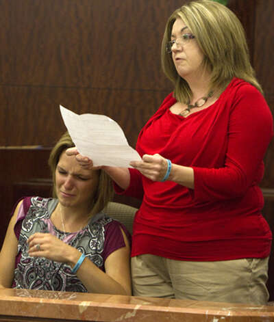 Alisha Will, left, reacts as her mom, Cyndee Graham, right, reads her statement during victim impact after the sentencing of Johoan Rodriguez for the death of her late husband Houston Police Officer Kevin Will in the 183rd state District Court Friday, June 8, 2012, in Houston. The judge sentenced Rodriguez to 55 years after he had plead guilty to intoxication manslaughter in the June 2011 death of Officer Will. (Cody Duty / Houston Chronicle) Photo: Cody Duty, Houston Chronicle / © 2011 Houston Chronicle