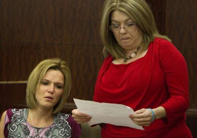 Alisha Will, left, reacts as her mom, Cyndee Graham, right, reads her statement during victim impact after the sentencing of Johoan Rodriguez for the death of her late husband Houston Police Officer Kevin Will in the 183rd state District Court Friday, June 8, 2012, in Houston. The judge sentenced Rodriguez to 55 years after he had plead guilty to intoxication manslaughter in the June 2011 death of Officer Will. (Cody Duty / Houston Chronicle) (Houston Chronicle)