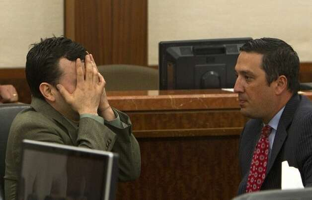 Attorney Rick Detoto, right, looks on as Johoan Rodriguez, left, reacts after he was sentenced 55 years for the death of Houston Police Officer Kevin Will in the 183rd state District Court of the Criminal Justice Center Friday, June 8, 2012, in Houston. Rodriguez received the sentence after he had plead guilty to intoxication manslaughter in the June 2011 death of Officer Will.  (Cody Duty / Houston Chronicle)