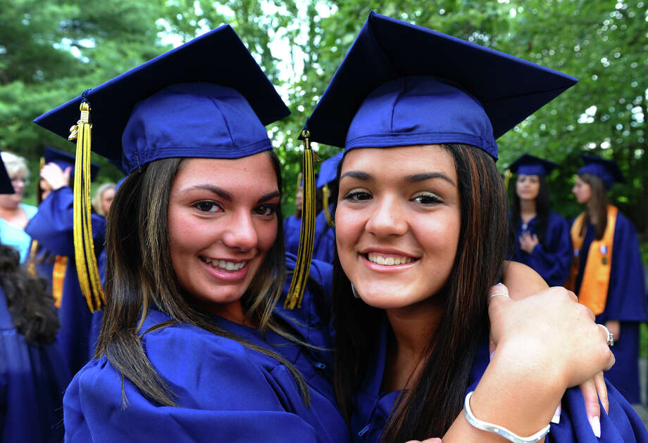 Graduates Amanda Marini, of Seymour, left, and friend Brittany Santos, of Bridgeport, pose for a photo before the start of Notre Dame of Fairfield's Class of 2012 Commencement Exercises in Fairfield, Conn. on Friday June 8, 2012. Photo: Christian Abraham / Connecticut Post