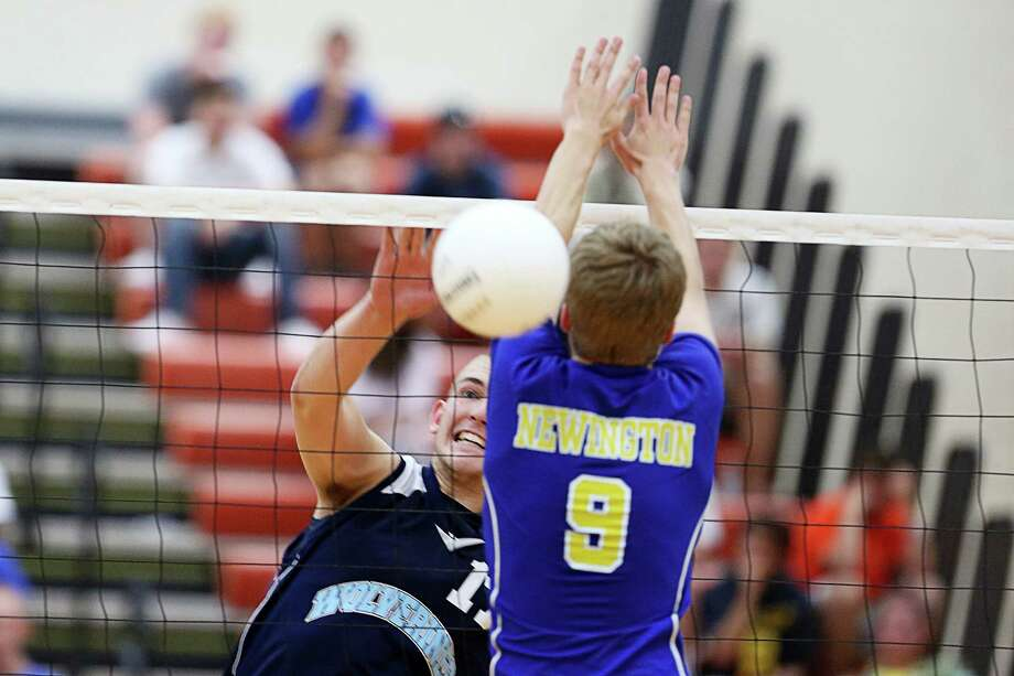 Oxford High School's Jonathan Vankamerik fires a shot past Tyler Willgoos of Newington High School in the class M boys volleyball final in Shelton, Conn. on Friday June 8, 2012.  Newington won the championship 3-1. Photo: Mike Ross / Connecticut Post Freelance