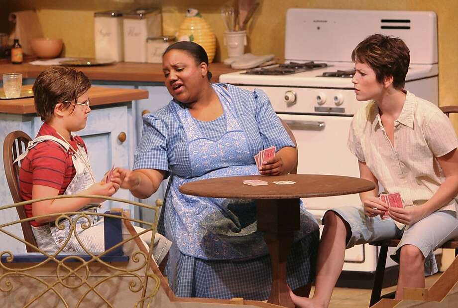 """Tomboy Frankie Addams (Katy Hidalgo, right) plays cards with the family cook, her surrogate mother Berenice (Alexaendrai Bond, center) and her young cousin John Henry (Ruby Buckwalter) in Douglas Morrisson Theatre's """"The Member of the Wedding"""" Photo: Terry Sullivan"""