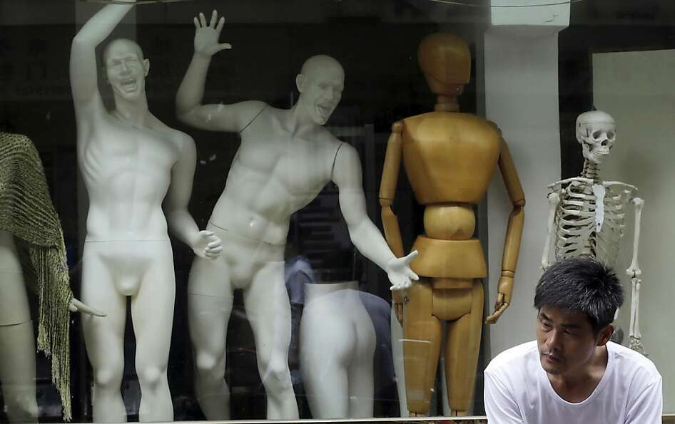 The evolution of the mannequin in Shanghai: From right, skeleton to wooden artist's model to