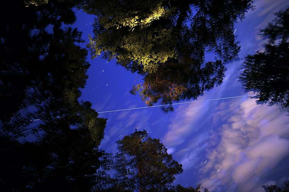 The International Space Station appears as a streak of light as it passes over the area at 8:51 p.m. providing a 6 minute long viewing opportunity Thursday June 7, 2012 in Birmingham, Ala. (AP Photo/The Birmingham News,Hal Yeager) Photo: Hal Yeager, Associated Press