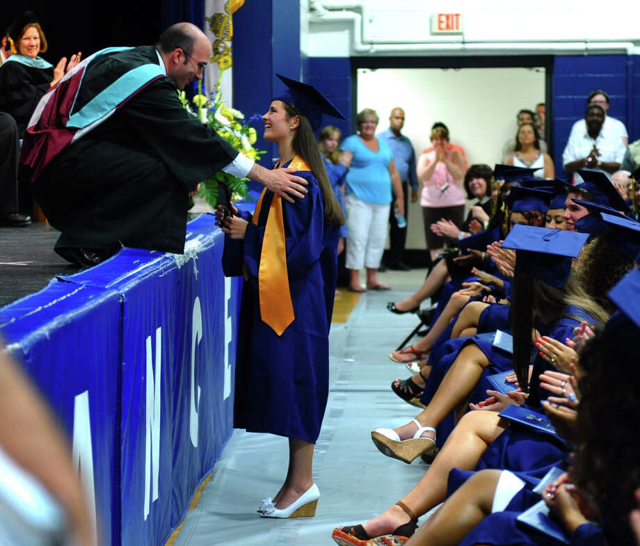 Graduate Mary Boyle, of Fairfield, receives the Outstanding Senior Award from Principal Christopher Cipriano, during Notre Dame of Fairfield's Class of 2012 Commencement Exercises in Fairfield, Conn. on Friday June 8, 2012. Photo: Christian Abraham / Connecticut Post