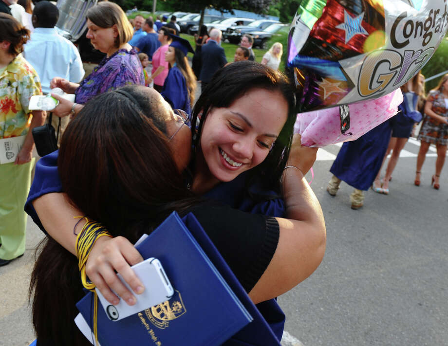 Graduate Jacqueline Rivera, of Bridgeport, gets a big hug from her mom Judith after Notre Dame of Fairfield's Class of 2012 Commencement Exercises in Fairfield, Conn. on Friday June 8, 2012. Photo: Christian Abraham / Connecticut Post