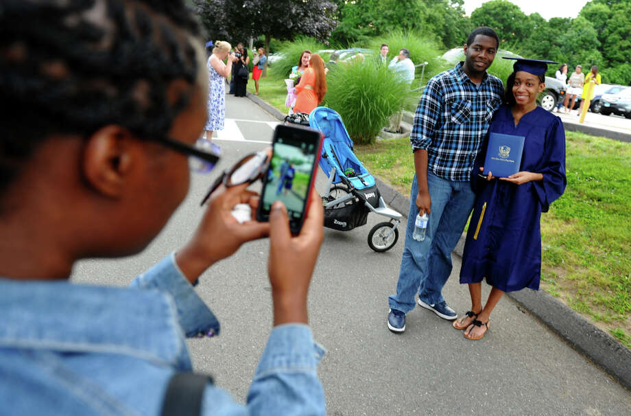 Graduate Kerianne Nelson poses for a photo with her brother Kevin, after Notre Dame of Fairfield's Class of 2012 Commencement Exercises in Fairfield, Conn. on Friday June 8, 2012. Photo: Christian Abraham / Connecticut Post