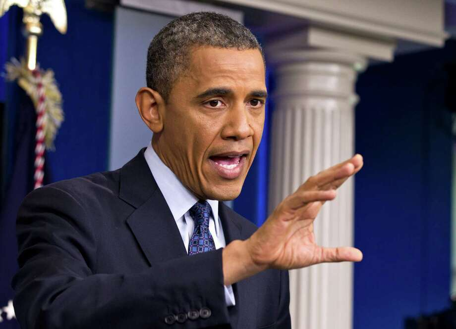 President Barack Obama talks about the economy, Friday, June 8, 2012, in the briefing room of the White House in Washington.   (AP Photo/J. Scott Applewhite) Photo: J. Scott Applewhite / AP