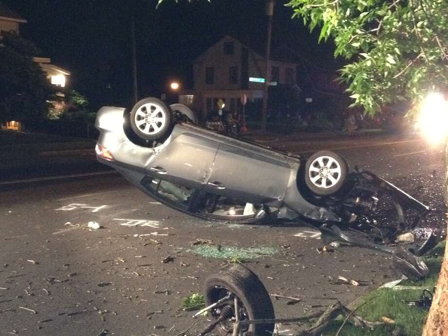 One of the cars that rolled over on Washington Avenue is seen Friday night. (Times Union / Jordan Carleo-Evangelist)