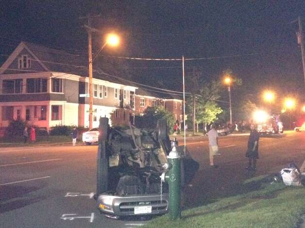 An SUV is upside down after an accident on Washington Avenue, Albany, on Friday night. (Times Union/Jordan Carleo-Evangelist)