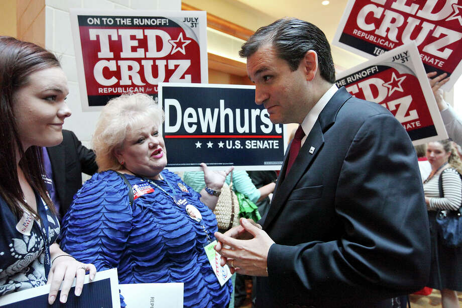 "Sara  Heinzman, 17, and her mother, Tarrant County delegate Sherri Heinzman, talk Friday with U.S. Senate candidate Ted Cruz before the Texas Federation of Repub-lican Women's ""Tribute to Women Luncheon"" during the GOP convention. Photo: Edward A. Ornelas / © 2012 San Antonio Express-News"