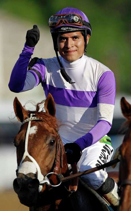 Jockey Mario Gutierrez reacts aboard I'll Have Another after winning the 137th Preakness Stakes horse race at Pimlico Race Course, Saturday, May 19, 2012, in Baltimore. (AP Photo/Patrick Semansky) Photo: Patrick Semansky / AP