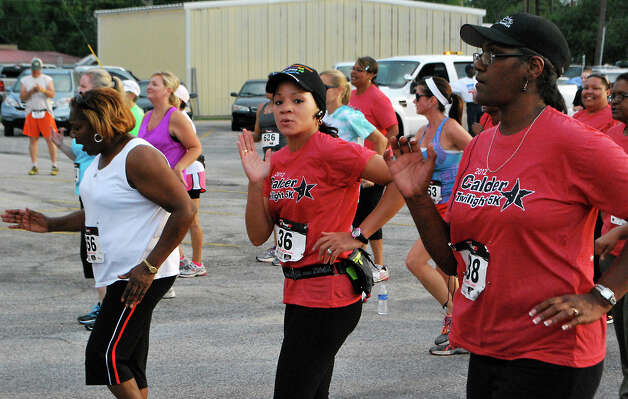 Residents gather to participate in the Calder 5k walk/run in Beaumont, Friday, June 8, 2012. Clay Thorp/The Enterprise Photo: TAMMY MCKINLEY
