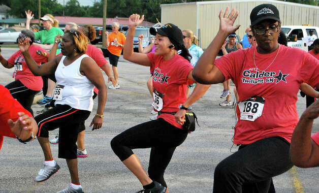 Residents warm up before participating in the Calder 5k walk/run in Beaumont, Friday, June 8, 2012. Clay Thorp/The Enterprise Photo: TAMMY MCKINLEY