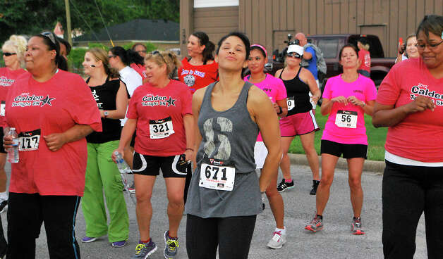 Julie Daniels warms up before participating in the Calder 5k walk/run in Beaumont, Friday, June 8, 2012. Clay Thorp/The Enterprise Photo: TAMMY MCKINLEY