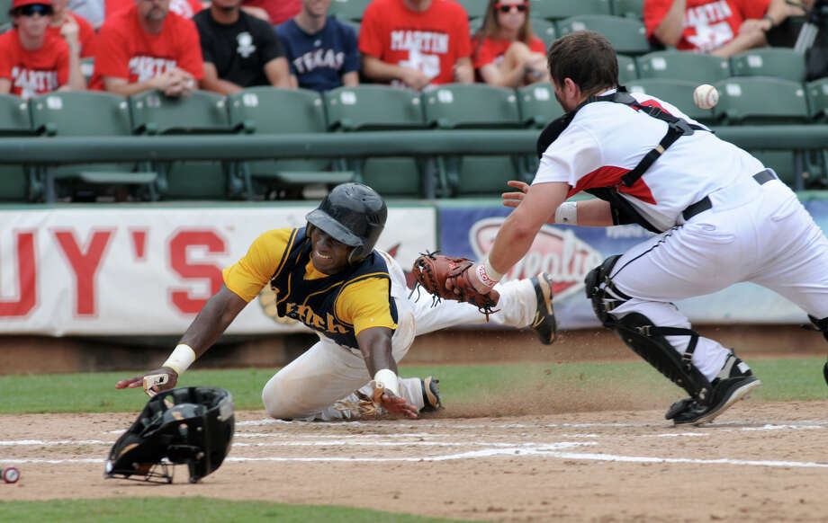 Cy Ranch senior shortstop Leon Byrd beats the tag of Arlington Martin catcher Collin Lawrence to score one of three runs in the third inning Friday in their Class 5A semifinal game. Photo: Jerry Baker
