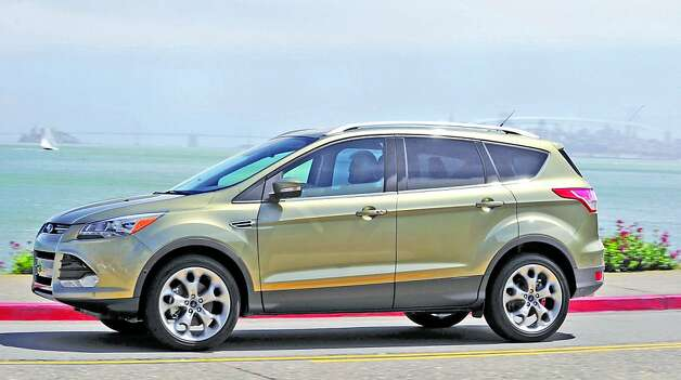 The 2013 Ford Escape takes on a more advanced and contemporary exterior styling that reflects Ford's new design language. The result does away with the old, boxy format and adopts a look more youthful and athletic. Photo: Ford, Wieck