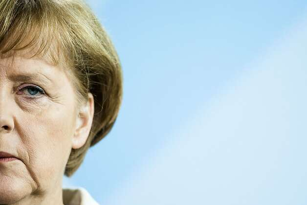 German Chancellor Angela Merkel reacts during a news conference with the Prime Minister of New Zealand John Key, unseen,  at the chancellery in Berlin, Germany, Friday, June 8, 2012. German Chancellor Angela Merkel says on the press conference that Spain hasn't yet sought outside help to deal with the troubles of its banks and Berlin won't pressure it into doing so. Merkel reiterated that all necessary institutions are ready if a country decides to seek assistance. (AP Photo/Markus Schreiber) Photo: Markus Schreiber, Associated Press