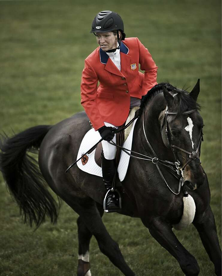 Pinque ==cq--  riding coat by Bay Area company, Ariat, to be worn by Show Jumping discipline equestrians at the Beijing Summer Olympics 2008 -- pictured: Beezie Madden. the No. 1 ranked show jumper in the U.S. . Photo: Courtesy Of Ariat Inter