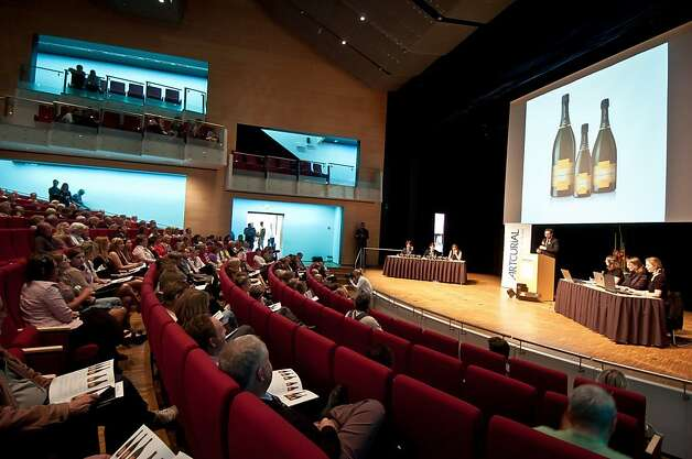 People attend the auction of a bottles of champagne found on the bottom of the Baltic, in Mariehamn, Aland, on June 8, 2012. A 200-year-old bottle of Veuve Clicquot Ponsardin champagne found on the bottom of the Baltic fetched 15,000 euros (18,600 USD) today in Finland, less than half what sale organisers had hoped. A total of 11 bottles of the world's oldest champagne were sold today for 109,280 euros (136,000 USD), two years after being salvaged from the sea off  Finland's autonomous island province of Aaland. Photo: Erkki Santamala, AFP/Getty Images