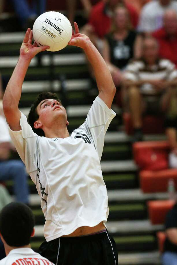 Ridgefield High School's Christopher Bruno sets the ball up in the class L boys volleyball final against Cheshire High School in Shelton, Conn. on Friday June 8, 2012. Photo: Mike Ross / Connecticut Post Freelance