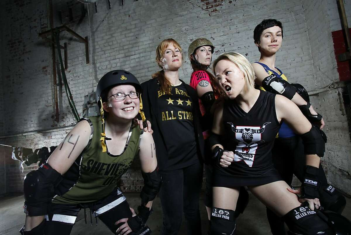 """From left, """"Mars Attack"""", Marianne LaFord of Shevil Dead, """"Miss Moxxxie"""", Melissa Chamberlain, the Bay Area All Stars coach, """"PsychoSeraPissed"""", Sara Post of the Berkeley Resistance, """"Lethally Blonde"""", Liz Vincent of the Oakland Outlaws, and """"Chiquita Bonanza"""", Laura Bruland of the Richmond Wrecking Belles, all play roller derby in Oakland, Calif., Thursday, June 7, 2012."""