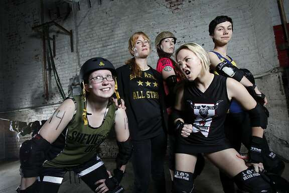 "From left,  ""Mars Attack"", Marianne LaFord of Shevil Dead,  ""Miss Moxxxie"", Melissa Chamberlain, the Bay Area All Stars coach, ""PsychoSeraPissed"", Sara Post of the Berkeley Resistance, ""Lethally Blonde"", Liz Vincent of the Oakland Outlaws, and ""Chiquita Bonanza"", Laura Bruland of the Richmond Wrecking Belles, all play roller derby in Oakland, Calif., Thursday, June 7, 2012."