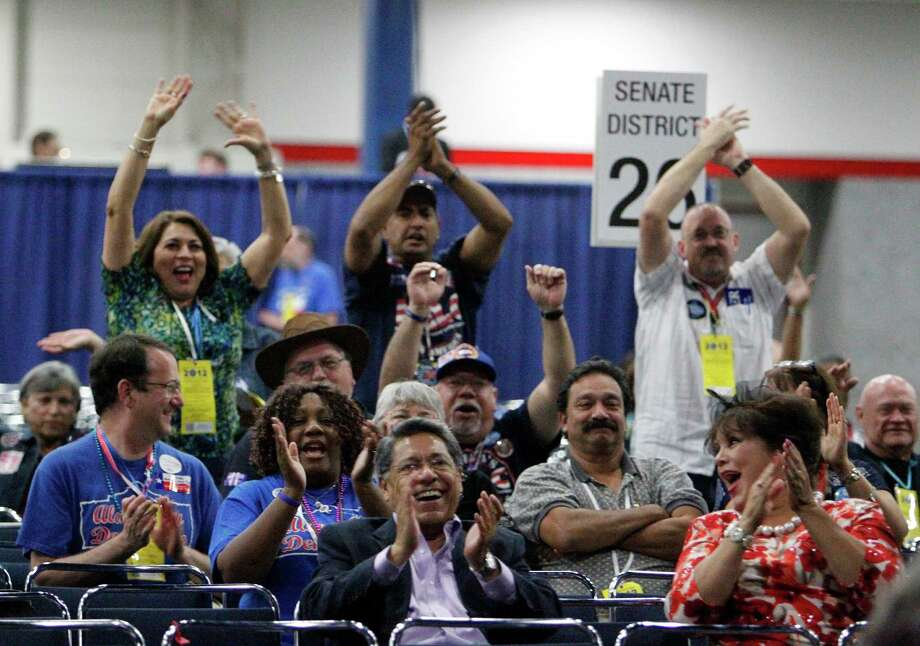 Supporters of San Antonio Mayor Julian Castro cheer as he speaks during the the 2012 Texas Democratic Party State Convention at the George R. Brown Convention Center Friday, June 8, 2012, in Houston. Photo: James Nielsen, Chronicle / © Houston Chronicle 2012