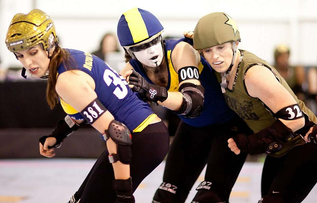 Razor Grrl, left, Demanda Riot, Nock Nock are seen during a bout between the Shevil Dead vs The Wrecking Belles