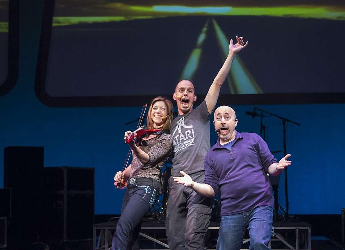 Gene Lewin (right), Brendan Milburn and Valerie Vigoda (left) hit the road in the world premiere of the new GrooveLily musical