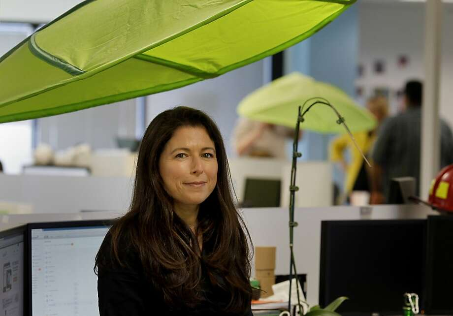 Laura Yecies sits near one of the green leafs that decorate the offices of SugarSync. Laura Yecies is CEO of SugarSync in San Mateo, Calif., an online storage company that competes with Dropbox using Cloud technology. Photo: Brant Ward, The Chronicle