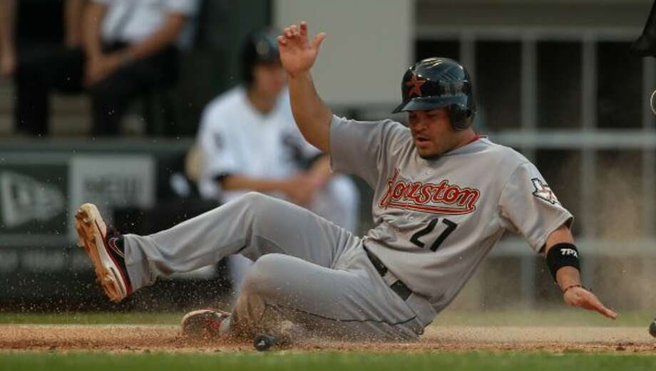 The Houston Astros' Jose Altuve on a sacrifice fly by Jed Lowrie in the first inning. (Phil Velasquez / MCT)