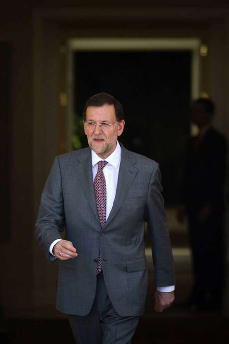 Spain's Prime Minister Mariano Rajoy, walks to welcome Netherlands' Prime Minister Mark Rutte at the Moncloa Palace, in Madrid, Thursday, June 7, 2012. Spain's Prime Minister appeared Thursday to have abandoned his insistence that the country's troubled banking sector will not need an external bailout, as for the first time he avoided ruling out such an option.(AP Photo/Daniel Ochoa de Olza) Photo: Daniel Ochoa De Olza / AP
