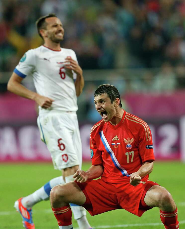 Russia's Alan Dzagoyev celebrates after scoring a goal during the Euro 2012, Group A soccer match between Russia and Czech Republic, in Wroclaw, Poland, Friday, June 8, 2012.  (AP Photo/Petr David Josek) Photo: Petr David Josek / AP