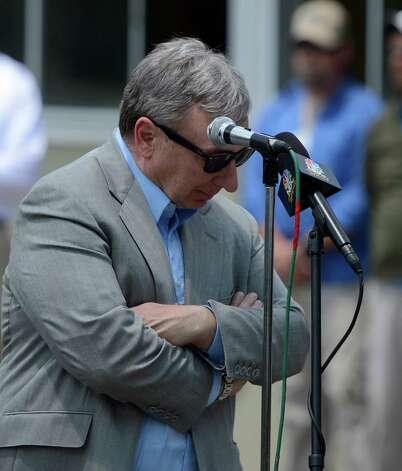 Owner J. Paul Reddam is overcome by emotion while announcing the retirement of I'll Have Another after tendonitis was discovered this morning after his exercise period at Belmont Park in Elmont, N.Y. June 8, 2012.   I'll Have Another was to try for the thoroughbred racing's Triple Crown in the Belmont Stakes tomorrow. (Skip Dickstein / Times Union) Photo: SKIP DICKSTEIN