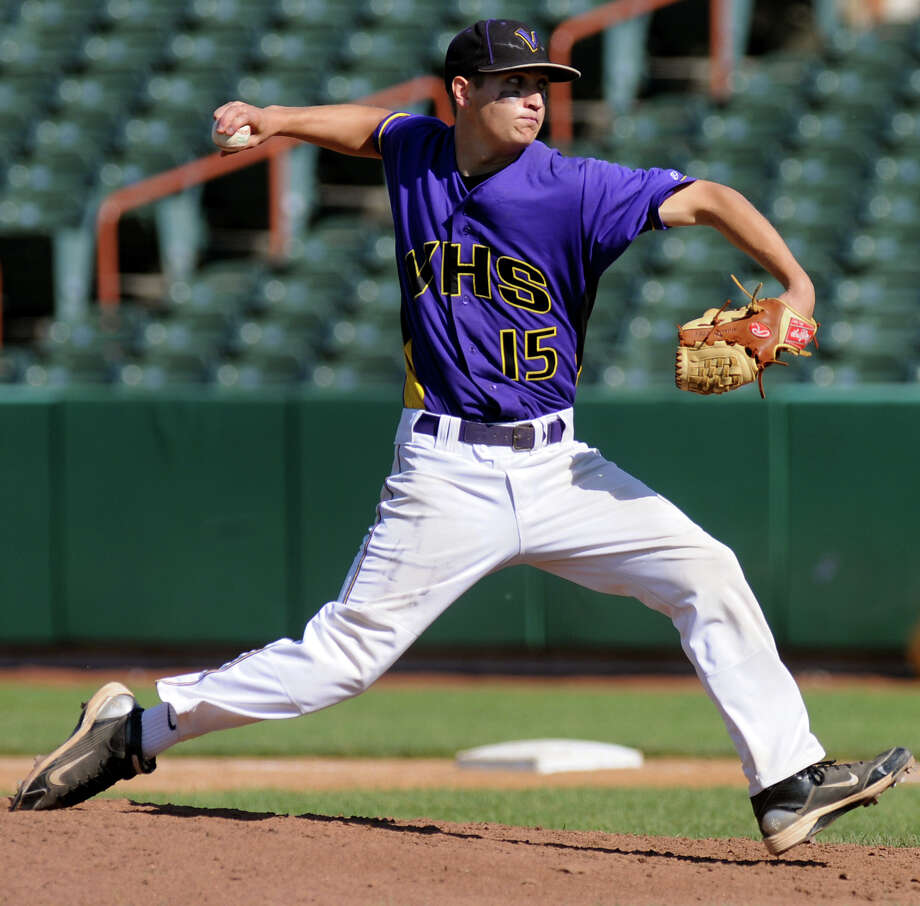 Voorheesville's Kevin Connolly (15) winds up the pitch during their Class C final baseball game against Hoosick Falls on Thursday, May 31, 2012, at Joseph L. Bruno Stadium in Troy, N.Y. (Cindy Schultz / Times Union) Photo: Cindy Schultz / 00017857A