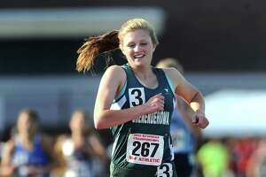 Shenendehowa's Elizabeth Predmore lets out a smile as she crosses the finish line to win the girls 3000 meter run during the 2012 NYSPHSAA Outdoor Track & Field Championships held at Cicero-North Syracuse High School on Friday, June 8, 2012. Adrian Kraus/Special to the Times Union