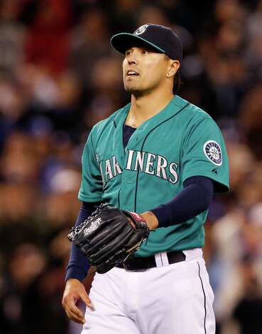 Seattle Mariners relief pitcher Brandon League leaves the field against the Los Angeles Dodgers in the eighth inning of a baseball game Friday, June 8, 2012, in Seattle. The Mariners won 1-0 in a six-pitcher combined no-hitter. Photo: AP