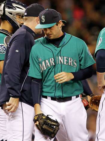 Seattle Mariners relief pitcher Lucas Luetge comes out against the Los Angeles Dodgers in the eighth inning of a baseball game Friday, June 8, 2012, in Seattle. The Mariners won 1-0 in a six-pitcher combined no-hitter. Photo: AP