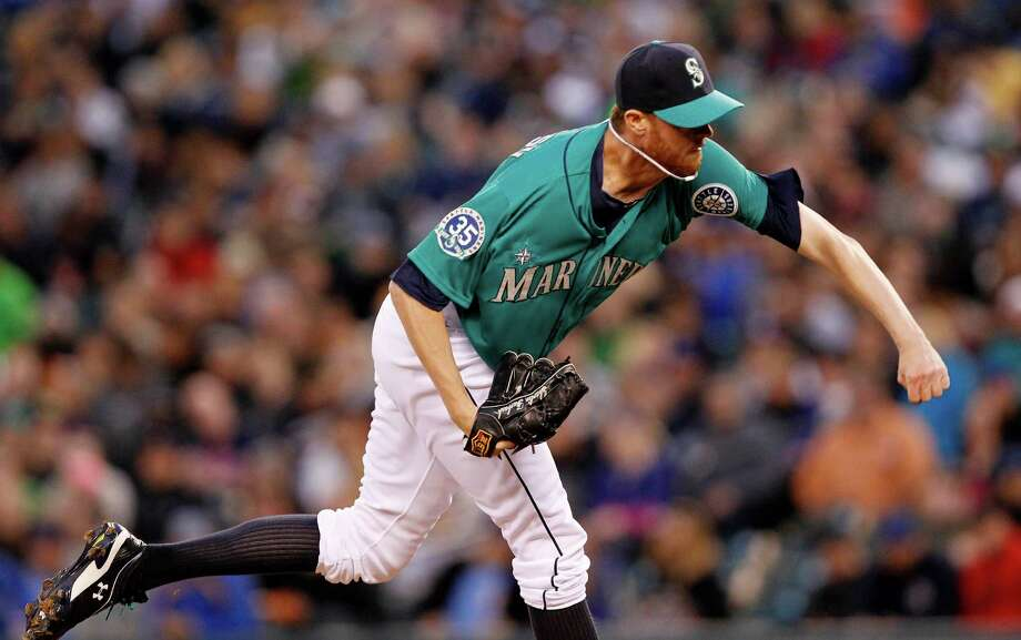 Seattle Mariners relief pitcher Charlie Furbush throws against the Los Angeles Dodgers in the seventh inning of a baseball game Friday, June 8, 2012, in Seattle. The Mariners won 1-0 in a six-pitcher combined no-hitter. Photo: AP