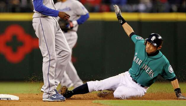 Seattle Mariners' Ichiro Suzuki steals second base unchallenged by the Los Angeles Dodgers in the seventh inning of a baseball game Friday, June 8, 2012, in Seattle. Photo: AP