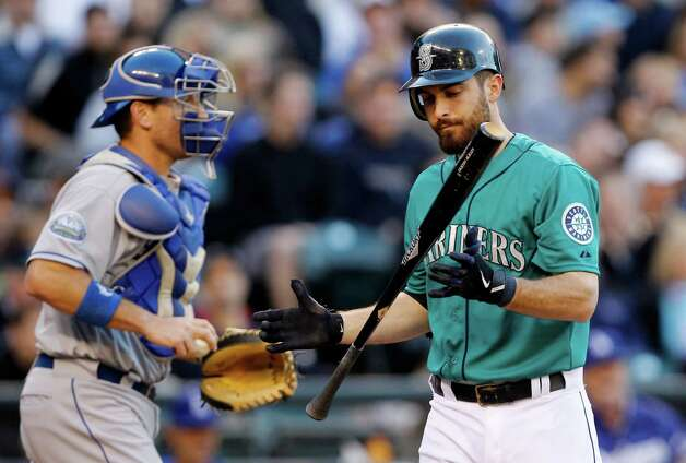 Seattle Mariners' Dustin Ackley, right, flips his bat after striking out as Los Angeles Dodgers catcher A.J. Ellis prepares to return the ball to the mound in the third inning of a baseball game Friday, June 8, 2012, in Seattle. Photo: AP