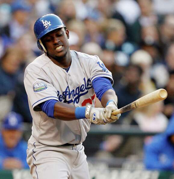 Los Angeles Dodgers' Elian Herrera reacts to swinging strike against the Seattle Mariners in the fou