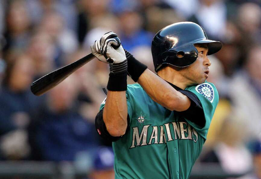 Seattle Mariners' Ichiro Suzuki singles against the Los Angeles Dodgers in the third inning of a bas