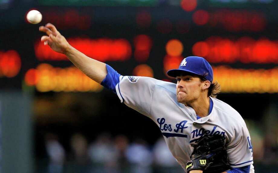 Los Angeles Dodgers starting pitcher Nate Eovaldi throws against the Seattle Mariners in the first inning of a baseball game Friday, June 8, 2012, in Seattle. Photo: AP