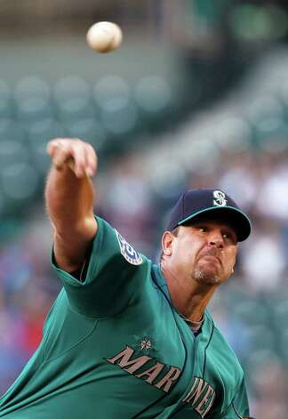 Seattle Mariners starting pitcher Kevin Millwood throws to a Los Angeles Dodgers batter in the second inning of a baseball game Friday, June 8, 2012, in Seattle. Photo: AP